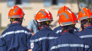 emergency workers wearing safety hats