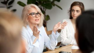 woman gesturing in meeting