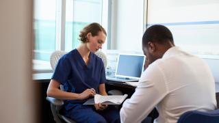 health care professional reviewing records with patient