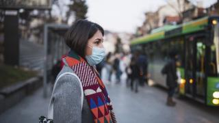 woman in town wearing protective face mask