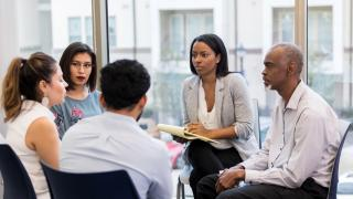 woman listening at team building meeting