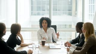 woman talking at meeting